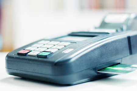 paying: Payment with credit card by paying POS terminal. Stock Photo