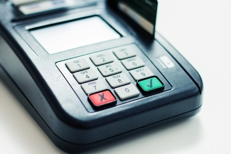 technology transaction: Payment with credit card by paying POS terminal. Stock Photo