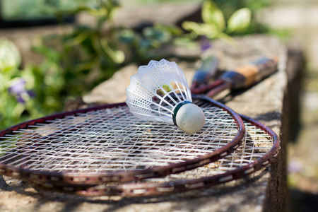entertainment equipment: Old fashioned badminton racket and shuttlecock outdoor. Stock Photo