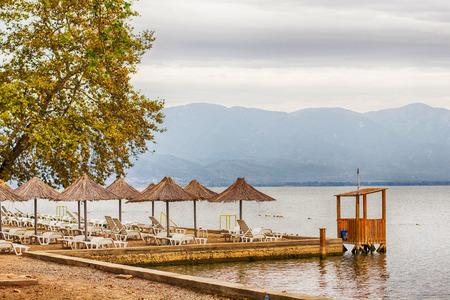 lake beach: Beach on Dojran lake, Macedonia, Europe. Summer travel vacation destination. Stock Photo