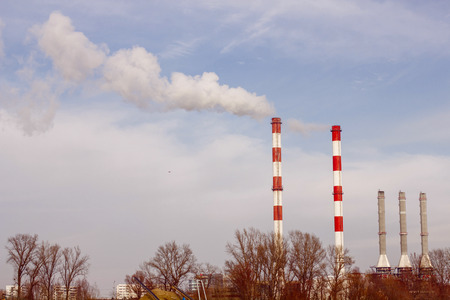 global environment: Smoke from chimney against blue sky.