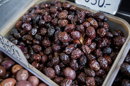 dried food: Black Olive dried, healthy food on the farmers market stand. Stock Photo