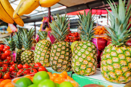variety: Fresh Exotic Ripe Pineapple Fruit at grocery street market.