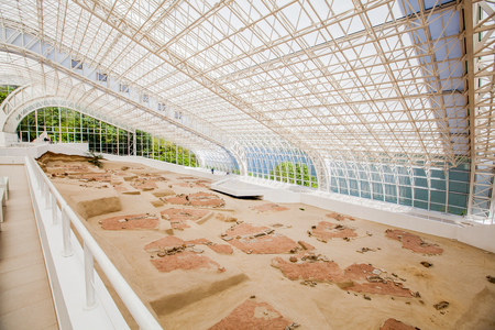 LEPENSKI VIR, SERBIA-APRIL 14, 2017: Mesolithic Archaeological site Lepen Whirl, between 95007200-6000 BC., visitor center under glass roof.