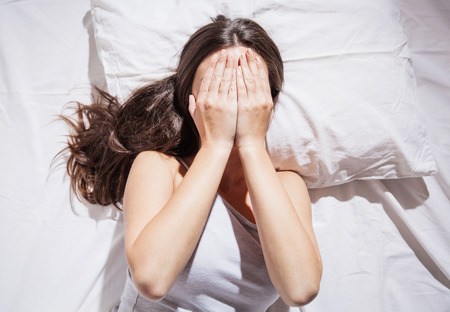Insomnia, depression, sleepless, sleep disorder, depressed woman cover her face with hands.