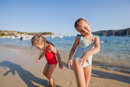 Children playing on the sand beach,Summer travel vacation.