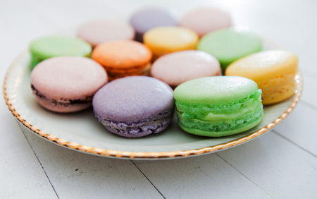Colourful sweet french macarons , handmade dessert , delicious tasty cake