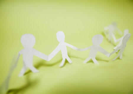 Connected support together, team paper doll people chain