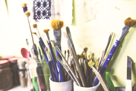 Selection of paintbrushes at arts workshop.
