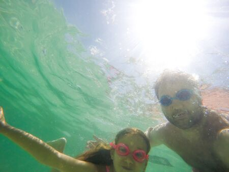 Father and daughter underwater portrait - Happy family summer fun - Making selfie under water