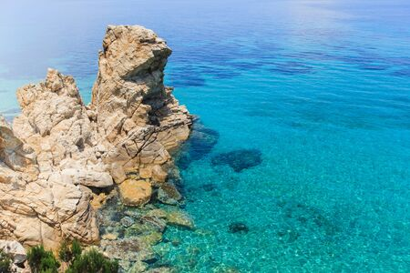 Panoramic view on scenic rocks formations and beautiful seascape on summer day . Natural monument on rocky beach at Greece.