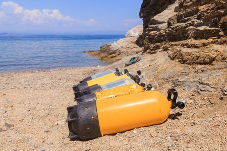 Scuba diving compressed air tanks on sand beach. Summer holiday activity on the sea . Reklamní fotografie - 148276902