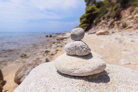 Balanced stones on the sea coast - Zen pebbles - Balance and harmony concept