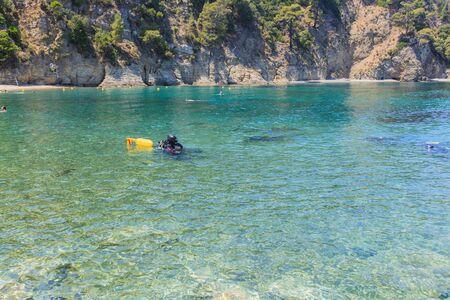 Summer holiday extreme activity. Scuba diving Reklamní fotografie - 148276965