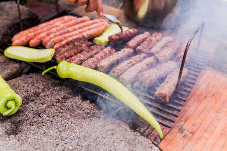 Grilling meat and hot pepper, Barbecue, BBQ party , camping food, outdoor activity