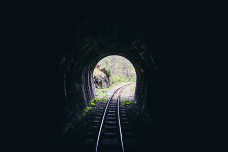 Old railway tunnel on Narrow-gauge railway, Tourist Attraction, old-fashioned travel, Journey through history