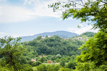 Beautiful nature landscape , panoramic view on countryside in Serbia, summer day, fresh air, amazing view, blue sky with clouds, green valley. Stok Fotoğraf