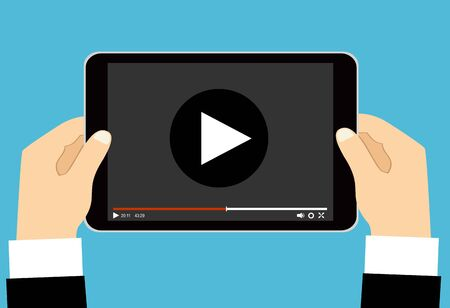 Hands holding tablet with video player on screen. Vector flat illustration. Vektorové ilustrace