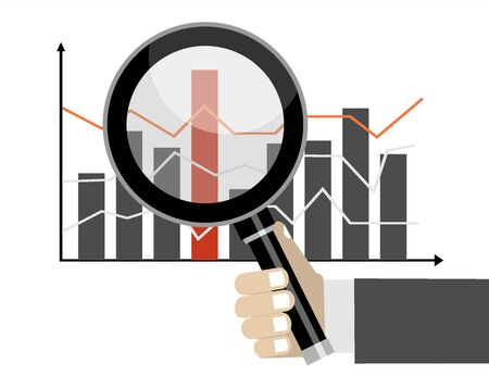 Business and stock market analysis concept. Hand holding magnifying glass over a chart