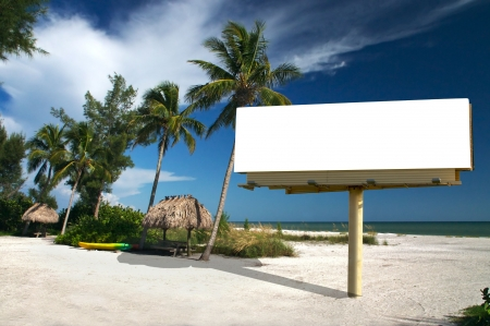 Tropical beach setting with a place to eat - included is a white billboard for you to place text or an advertisement - maybe for a travel ad? Stock Photo - 1342109