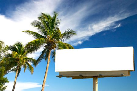 Tropical palm trees and a billboard in the late afternoon sun. The golden hour. Advertise your holiday specials! photo