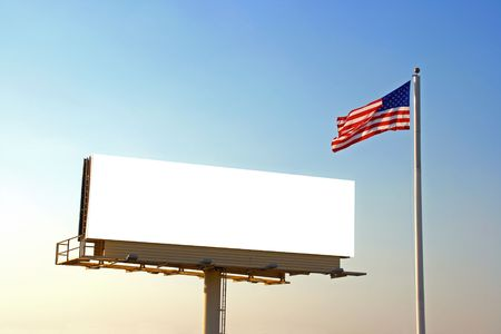 adboard: A roadside billboard with an American Flag next to it. The sun was behind the billboard and to the left