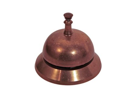 bellhop: Old brass hand bell - used for getting someones attention. Often used on the front desk at a hotel to call the bellhop. Overhead view - isolated on white