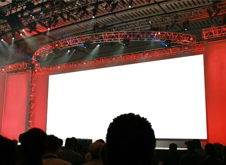 The stage at a keynote presentation for a large conference... the screen has been blanked out for you to fill in your own message. Stock Photo