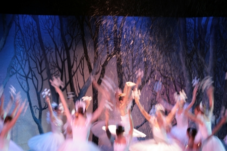 Dancers performing a snow scene in the Nutcracker. Intentionally blured to show motion and the snow falling Stock Photo