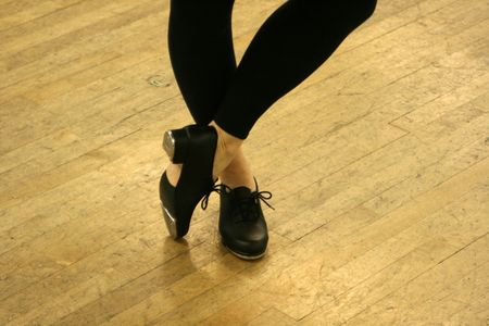 Tap Dancer poses with taps exposed.