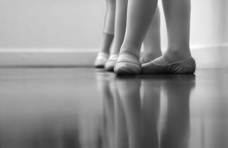 Ballet dancers feet and legs. Intentionally shot at high ISO to give a grainy, old time feel - with selective noise reduction applied. Black and white