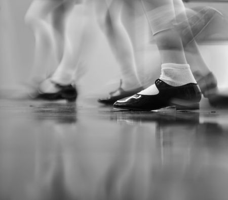 Young dancers are learning - this group is vigorously tapping with tap shoes. Lots of motion - Black and white view Stock Photo - 2066827