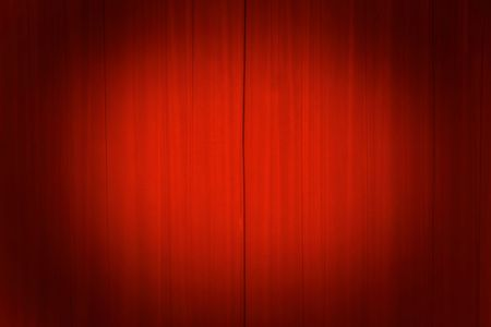 evening out: Bright red theater curtains with a spotlight on the center. Stock Photo