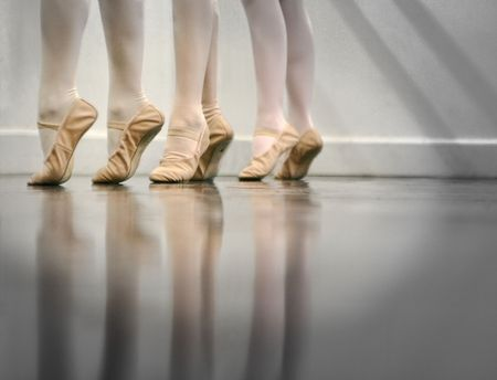 Ballet Dancer Feet - This is a newer version of a popular image... this one is darker and focusses more on the dancers feet Stock Photo