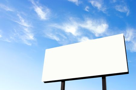 Brand new billboard and a wispy blue sky - the sun was on the left in the background sky giving a lighter left side of the image. photo