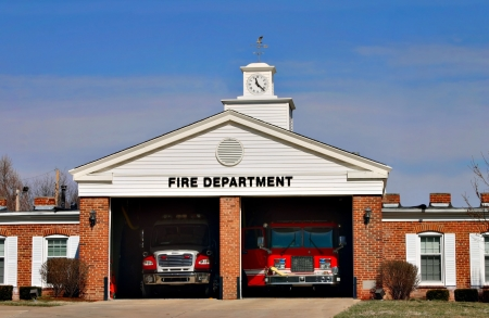 fire truck: An urban fire station ready to go
