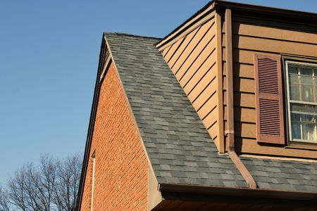 roof shingles: The same house as the other photos where the roof was falling off - now it is repaired and looks great!