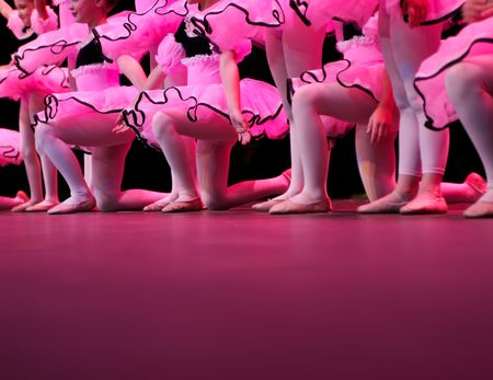 show off: a group of young dancers show off their talent and bright costumes - image highlights a narrow depth of field Stock Photo