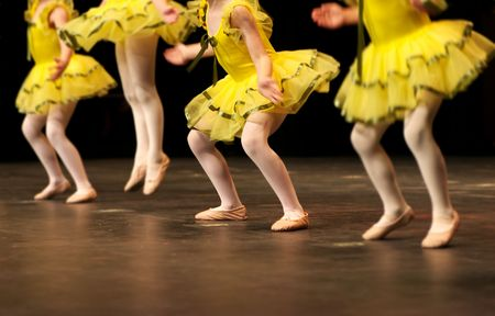 a group of young dancers show off their talent and bright costumes - image highlights a narrow depth of field Stock Photo