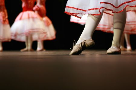 Dancers on stage during a recital. Noise reduction was applied on the floor and the dancers in the background but not the foreground dancers. Stock fotó