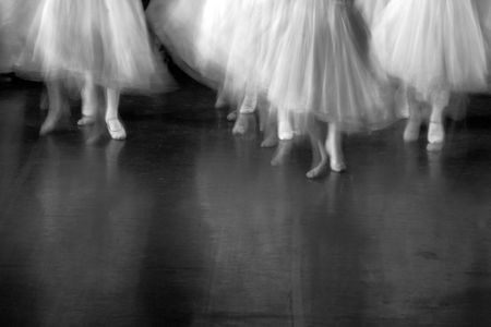 evident: Dancers on stage during a recital. Lots of motion evident - B&W