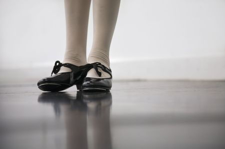 tap dance: Young dancer in tap shoes... low angle shot of just feet and legs  Stock Photo