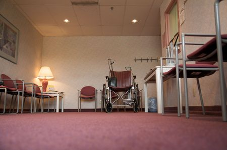 A doctors office waiting room with a wheelchair Stock Photo