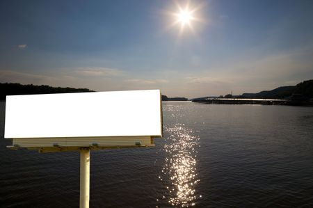 Brand new billboard in the setting sun over the mississippi river. photo