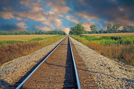 railway transportation: Train tracks running into the distance Stock Photo