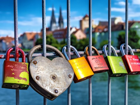 Colorful padlocks in Regensburg Redakční