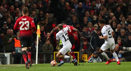 MANCHESTER, ENGLAND - FEBRUARY 12 2019: Dani Alves of PSG  mould Paul Pogba of Manchester United during the Champions League match between Manchester United and Paris Saint-Germain at Old Trafford Sta 報道画像