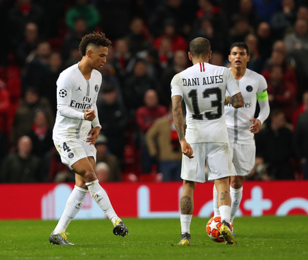 MANCHESTER, ENGLAND - FEBRUARY 12 2019:Thilo Kehrer of PSG  and Dani Alves during the Champions League match between Manchester United and Paris Saint-Germain at Old Trafford Stadium.
