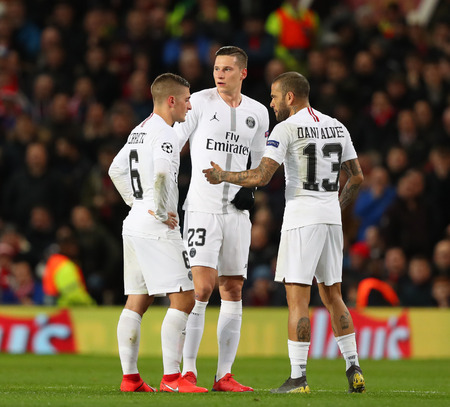 MANCHESTER, ENGLAND - FEBRUARY 12 2019: Dani Alves of PSG berates team mates Marco Verratti and Julian Draxler during the Champions League match between Manchester United and Paris Saint-Germain at Old Trafford Stadium.