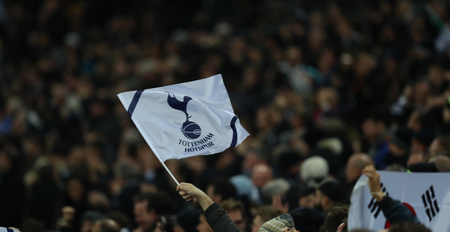 LONDON, ENGLAND - FEBRUARY 13 2019: A general view of a Tottenham flag during the Champions League match between Tottenham Hotspur and Borussia Dortmund at Wembley Stadium, London.
